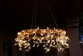now cover the ring with the fairy lights leaving some parts of the string hanging loose to make the chandelier look more beautiful