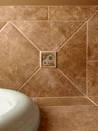decorative marble tile inserted into bathroom wall tiles
