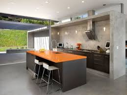use white stools and dark stainless steel kitchen island to