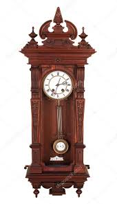 antique wall clock with a pendulum in a carved wooden housing stock image
