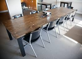 12 wooden conference table stained dark walnut top with painted black base top includes wire access holes