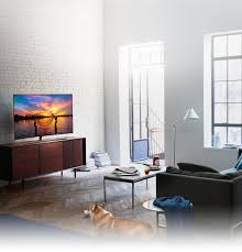 QLED TV has been set in the living room where the morning sun shines  brightly and ...