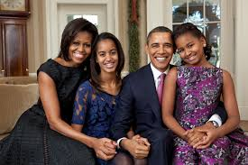 president barack obama first lady michelle obama and their daughters sasha and malia barack obama enters oval