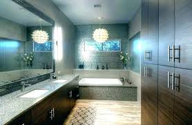 modern chandelier over bathtub chandelier over bathtub modern bathroom ideas with brown vanities and pendant cry