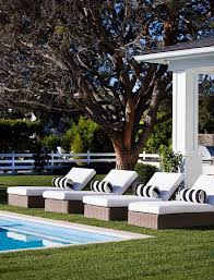 pool house furniture. pool lounges with white cushion and black lumbar pillows house furniture h