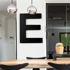 giant black wooden letter on wall