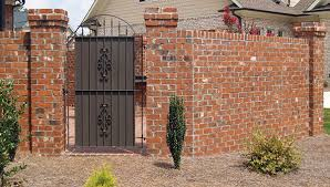 how to hang a gate to a brick wall