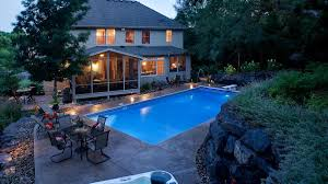 after after a massive boulder retaining wall was built to create a level space for the swimming pool