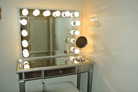 gl makeup vanity set with lighted mirror in the corner of the room