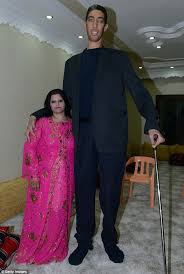 tallest woman in the world 2013 height. Beautiful Height The Worldu0027s Tallest Man Sultan Kosen Poses With His Fiancee Merve Dibo  During Their Henna Night With Tallest Woman In World 2013 Height B