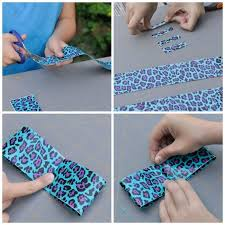 use one of your small pieces of tape to tape the edges down you will now have a loop this will form the bow duct tape 2
