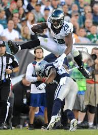 sports chloe elmer photography philadelphia s demarco murray 29 leaps over dallas cowboy brandon carr 39 during