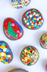 use puffy paint to give puffy painted rocks a classic craft with a twist use puffy paint to give