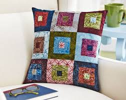 easy pillow designs. a pillow of log cabin blocks showcases beautiful batiks in rainbow colors. easy designs