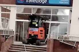 viral shows furious worker wreck travelodge with digger as he hadn t been paid the enraged driver slammed the digger through the glass doors