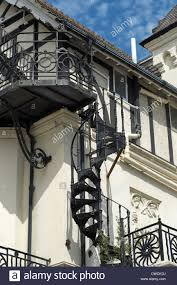 Wrought iron spiral staircase fire escape on the side of a building