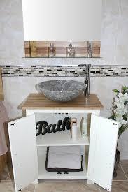 marble bathroom sink. Grey Marble Basin On Oak Top Vanity Unit With White Painted Base - Doors Open Bathroom Sink A