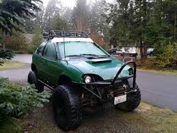 geo metro on a s10 blazer frame with 3 1 2 inch lift 36in tires and a built 2 8l and its for 3k