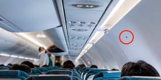 What those <b>little</b> black triangle <b>stickers</b> in your <b>airplane</b> cabin really ...