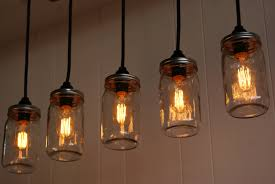five clear glass bottle pendant lamp design in edison style with black plastic lamp holder together