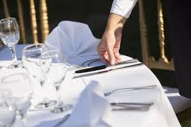 glasses table setting. Waiter Setting The Table In Restaurant Glasses
