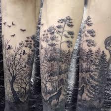 лес с птицами и волком тату на предплечье у парня добавлено