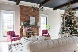 vintage living room black ceiling brick fireplace dark wood beams anthropologie home tufted sofa 1 of 23