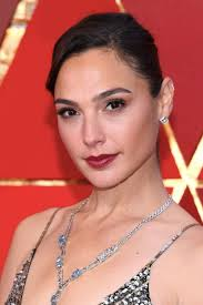 gal gadot rocked quite an understated look on the oscar red carpet and let her jewels do all the talking probably a good idea of you plan to wear