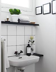 grout bathroom. contrasting tile and grout in a swedish bathroom with white square field black