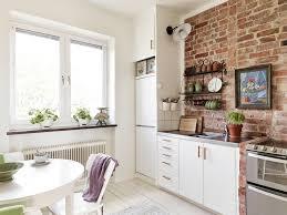 cute cream brick kitchen wall tiles white solid wood kitchen cabinet black metal chrome shelves grey