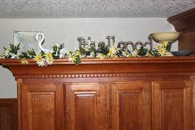 Decorating Above Kitchen Cabinets Ideas For Top Of Kitchen Cabinets Perfumevillageus