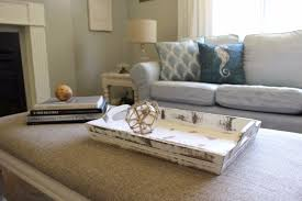 the two glass lamps topped with linen shades sitting on each side of the sofa were purchased new from sears for a fabulous