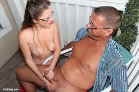 Naked wife gives handjob to husband