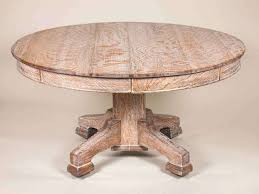 oak round table a large limed oak circular dining table with a cruciform base c oak