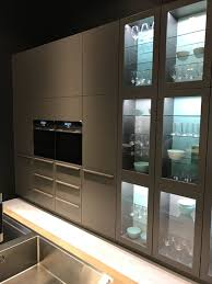 cabinets feature glass panels instead of solid doors even the lower sections view in gallery