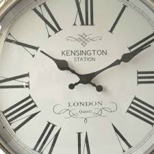 large silver round pocket watch wall clock