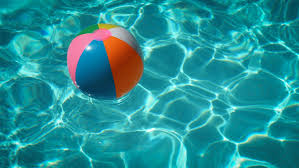 pool water with beach ball. A Beach Ball Floating On Water In Swimming Pool Free Photo With