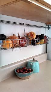 Tips To Organize A Small Kitchen Hanging Baskets under cabinets