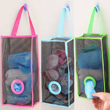 carrier bag storage. hanging mesh net carrier bag storage holder dispenser store recycle kitchen n
