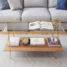 As a living room icon, this coffee table is endowed with rustic, industrial style. Amazon Com Nathan James Asher Mid Century Rectangle Coffee Table Glass Top And Rustic Oak Storage Shelf With Sleek Brass Metal Legs Gold Furniture Decor