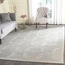 wrought studio hand tufted light gray ivory area rug and couch hand tufted gray ivory area rug and zebra