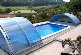 glass swimming pool fence cost telescopic enclosures between buildings london on top of building