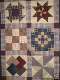 hand made amish quilt wall hanging and
