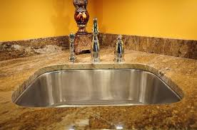 using soap and a microfiber cloth is one way of how to clean granite countertops