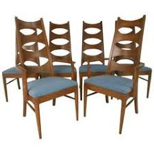 set of mid century modern cat eye dining chairs by kent coffey