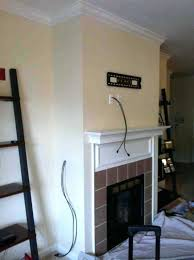concealing wires wall fireplace mounted install tv over wiring putting on brick can you put above