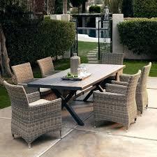 modern plastic wicker outdoor furniture on synthetic garden resin patio