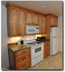 Cheap Compact Kitchen Cabinet Design With White Fridge