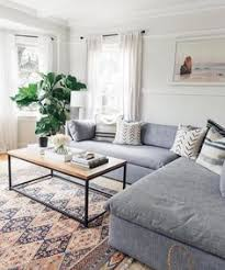 my favorite quality of this room is the contrast of patterns the rug adds a grey couches living