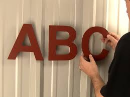 how to mount sign letters on corrugated surfaces position the lettering in the holes without